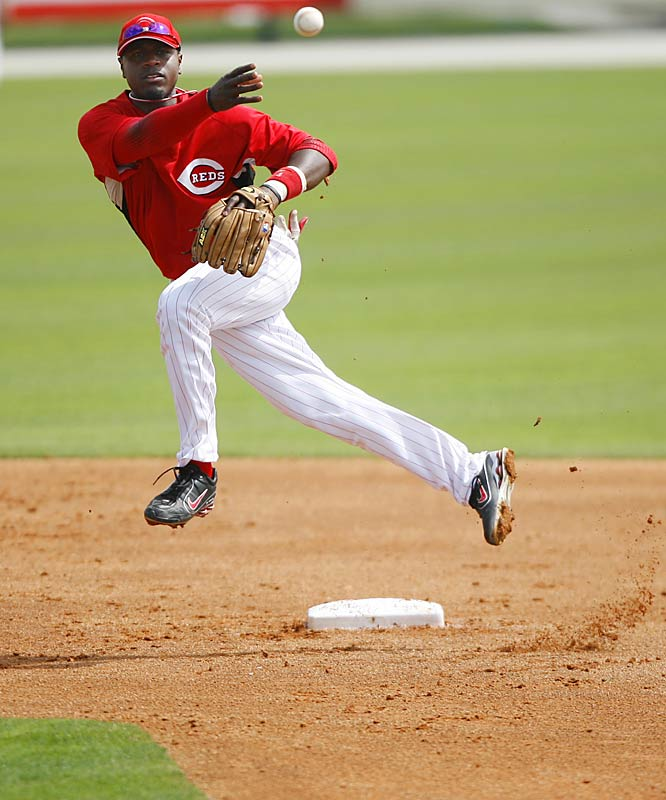 Second baseman Brandon Phillips makes the throw to first.