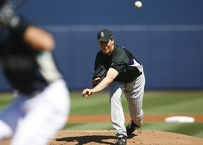 Jeff Francis pitches in a spring training game against the Mariners in Peoria, Ariz.