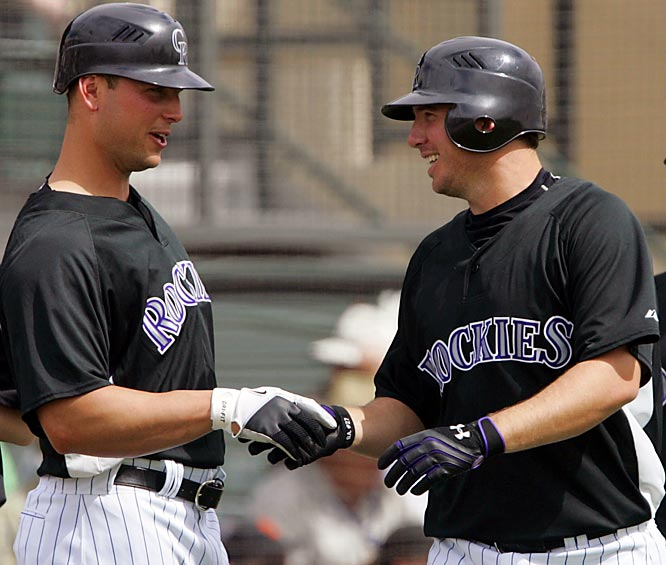 Matt Holliday, left, batted .326 last season with 34 home runs and 114 RBIs, and teammate Garrett Atkins batted .329 with 29 homers and 120 RBIs.