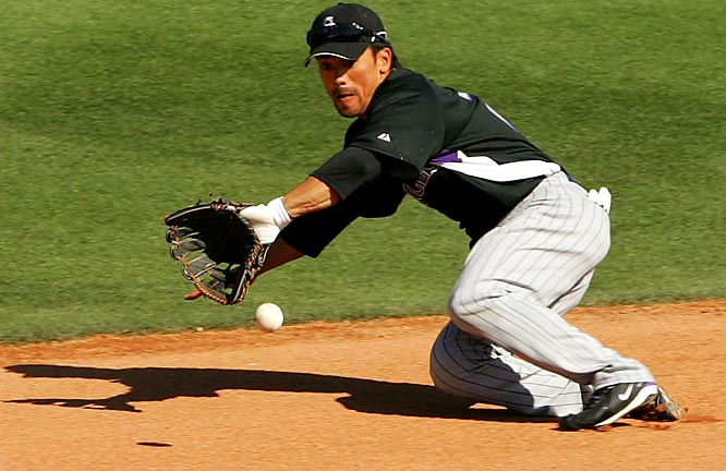 Second baseman Kazuo Matsui, who batted .345 in 32 games with the Rockies last season, fields a hard hit ground ball in the game against the Mariners.