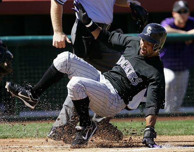 Willy Taveras appears to be imitating Carroll as he scores a run against the Giants during a game in Scottsdale, Ariz.