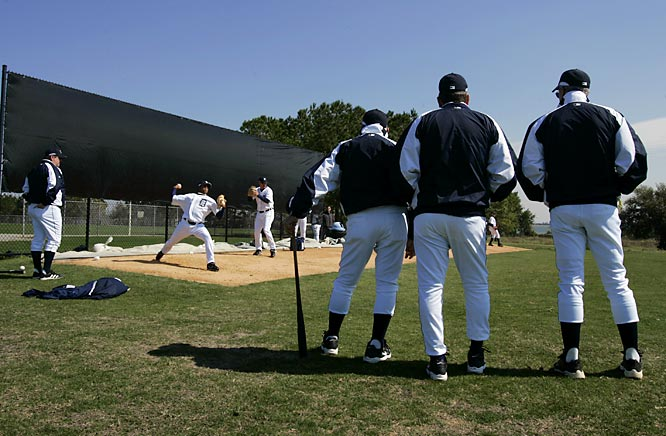 Manager Jim Leyland and his coaches watch their pitchers, including prospect Jair Jurrjens (at left).