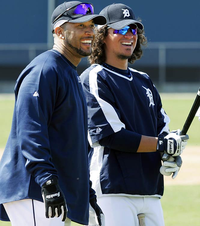 Newcomer Gary Sheffield, left, gets acquainted with teammate Magglio Ordonez during bunting practice on the first day of full-squad workouts.