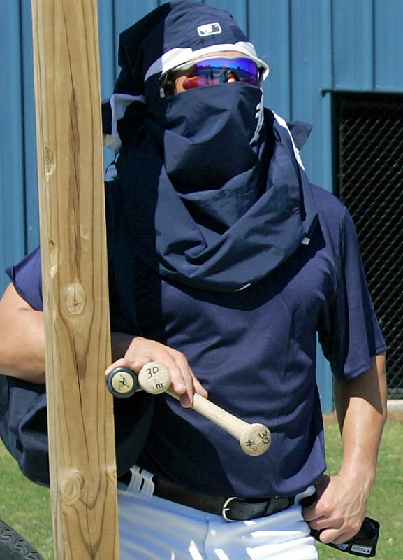 Magglio Ordonez tries a disguise in a failed attempt to hide from fans before leaving the practice fields.