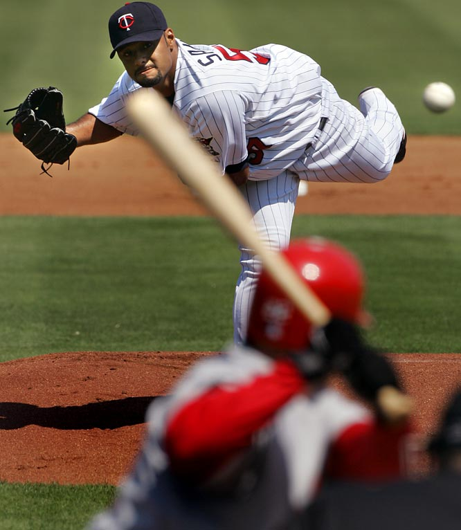 Reigning AL Cy Young winner Johan Santana delivers a pitch to St. Louis' David Eckstein.