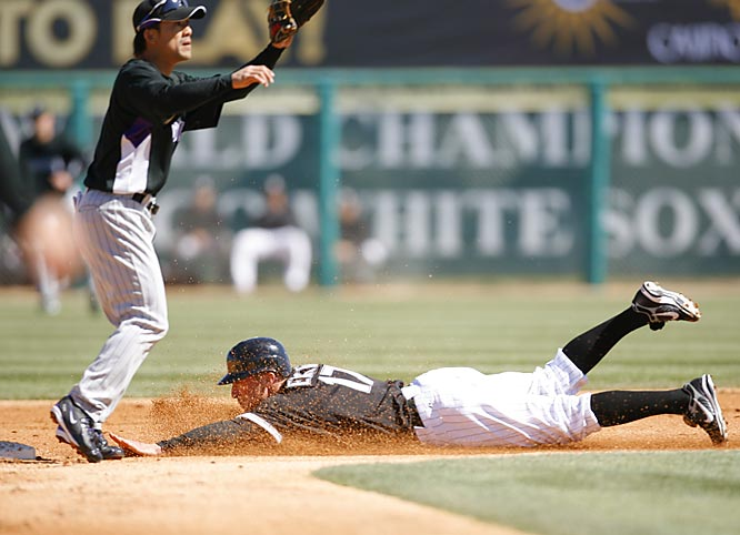 Darin Erstad beats the throw to the Rockies' Kazuo Matsui while stealing second in his first game with the White Sox.
