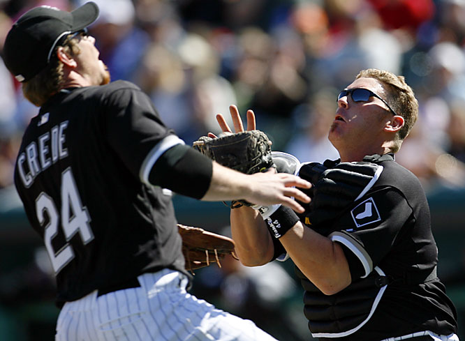 Toby Hall catches a popup despite nearly colliding with Joe Crede.
