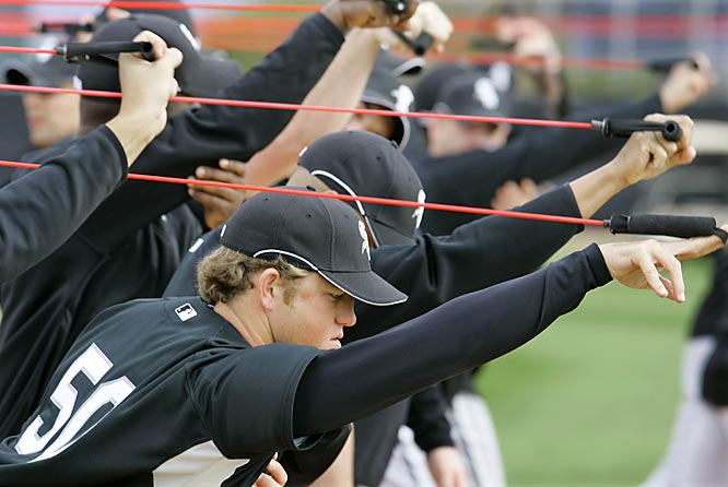 Pitcher Sean Tracey goes through stretching drills with teammates.