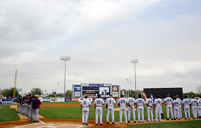 The Yankees and Twins line up before their spring opener.