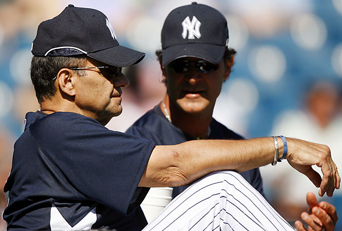 Joe Torre talks strategy with his new bench coach, Don Mattingly.