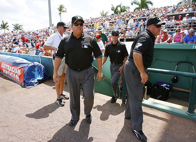 The umpires take the field; Culbreth is at left and O'Nora at right. Umpires are closer to perfect than you think: They made only 100 incorrect calls in 2006, excluding balls and strikes.
