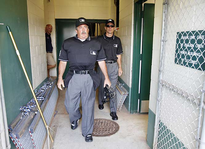 "Verducci and Tschida in the tunnel en route to the field. ""I tell all the young umpires that come up from the minors,"" says Tschida. ""`Expect a close play every time.'"""