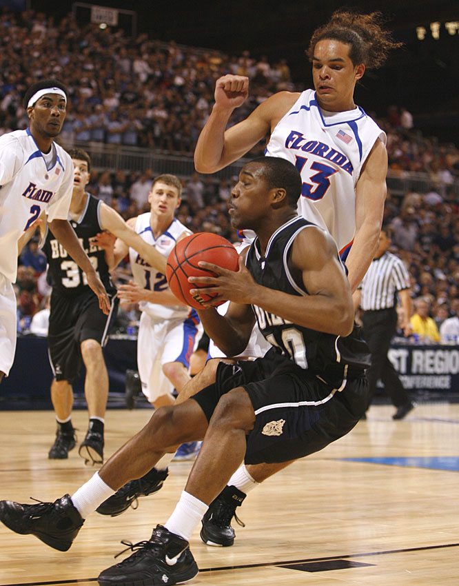 Butler's Mike Green loses his footing while Florida's Joakim Noah defends in the first half of the Gators' victory.