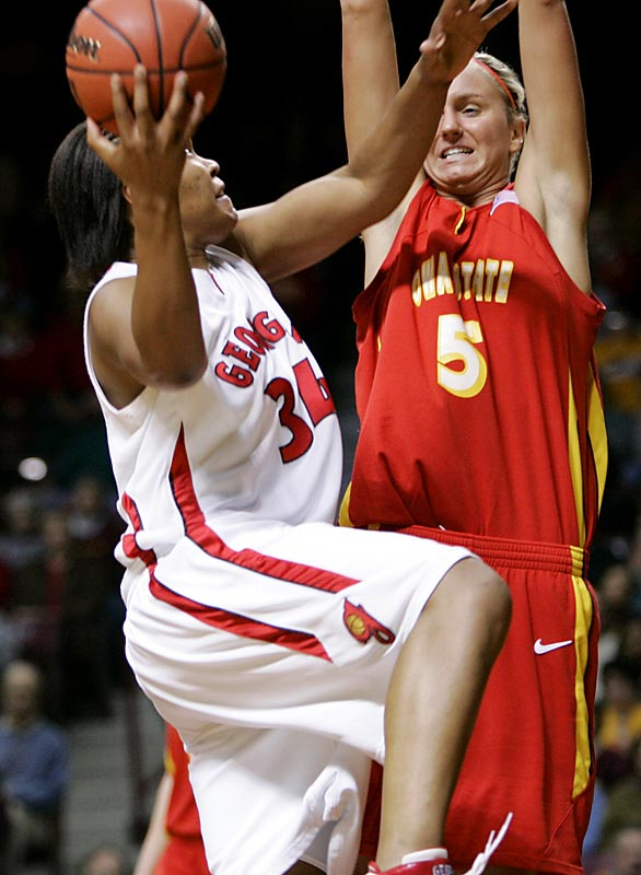 Georgia's Tasha Murphy attempts to squeeze a sky hook past the outstretched arms of Iowa State's Nicky Wieben. The Bulldogs knocked out the Cyclones to advance to the Sweet 16.