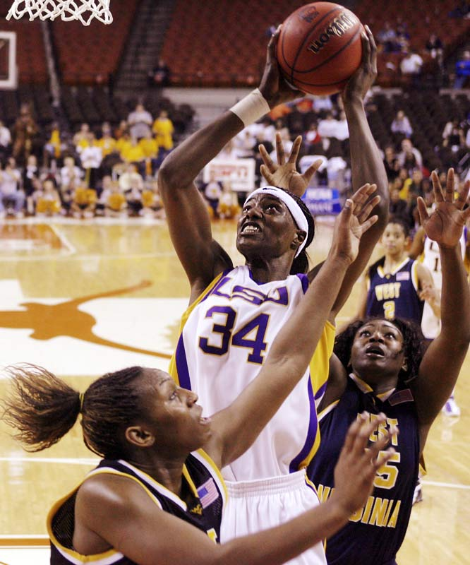LSU center Sylvia Fowles gets a shot over the outstretched arms of West Virginia's Chakhia Cole (front) and Olayinka Sanni.  The Tigers advanced to the Sweet 16 with a 49-43 victory.