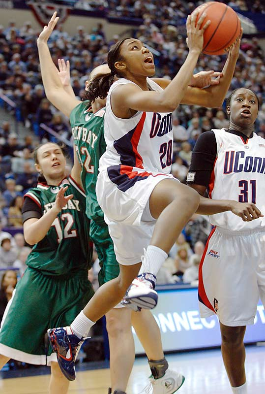 UConn's Renee Montgomery swoops in for a layup against the University of Wisconsin-Green Bay. The Huskies knocked out the Phoenix   94-70, to advance to the Sweet 16.