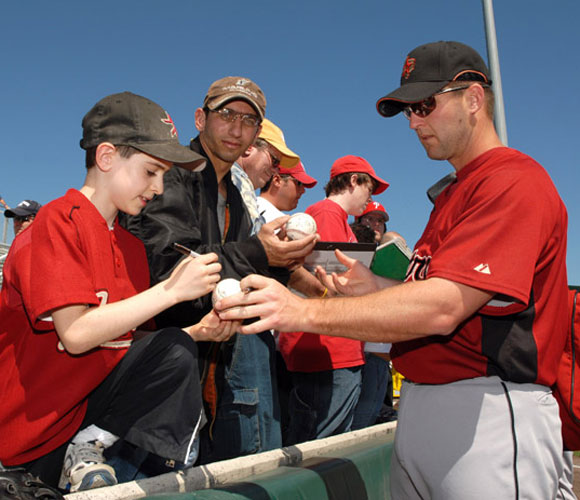 We understand that Astros outfielder Jason Lane (right) isn't a superstar, but we still say the autographs should be done the other way around.