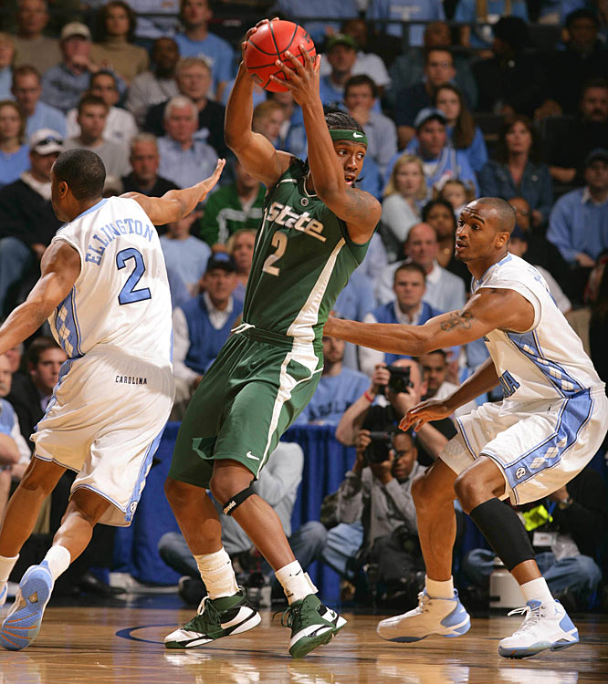 Raymar Morgan, who scored a career-high 19 points, fights off two Tar Heel defenders.