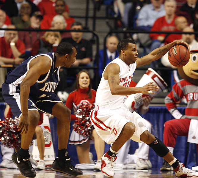 The Buckeyes' Daequan Cook saves the ball before it goes out of bounds.