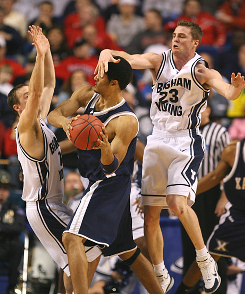 BYU's Jimmy Balderson catches Josh Duncan across the face in a physical, back-and-forth game that went to the Musketeers.
