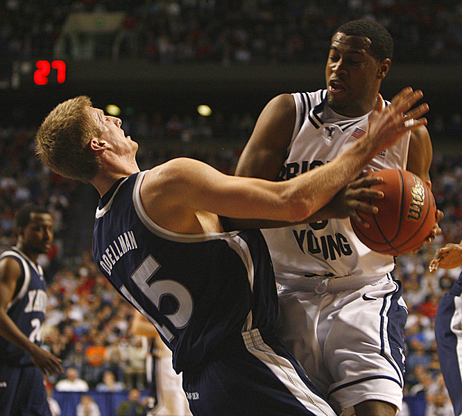 Keena Young, who led BYU with 24 points and 10 rebounds, collides with Xavier's Justin Doellman, who led the Musketeers with 23 points.