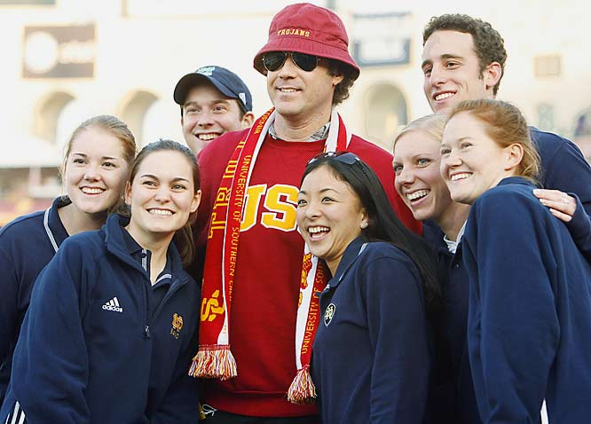 USC alum Will Ferrell, who graduated with a degree in Sports Information, is caught posing with members of the <b>Notre Dame</b> marching band. Shame on you, Will.