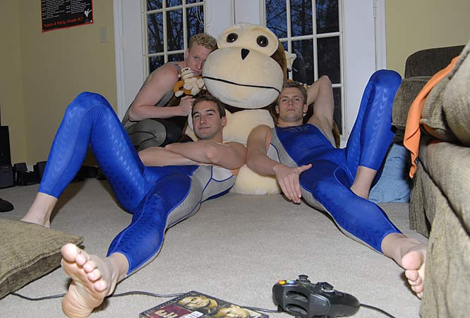 Maras, Smith and  Weniger chill out with Monkey, the swimmers' house mascot, in their living room.
