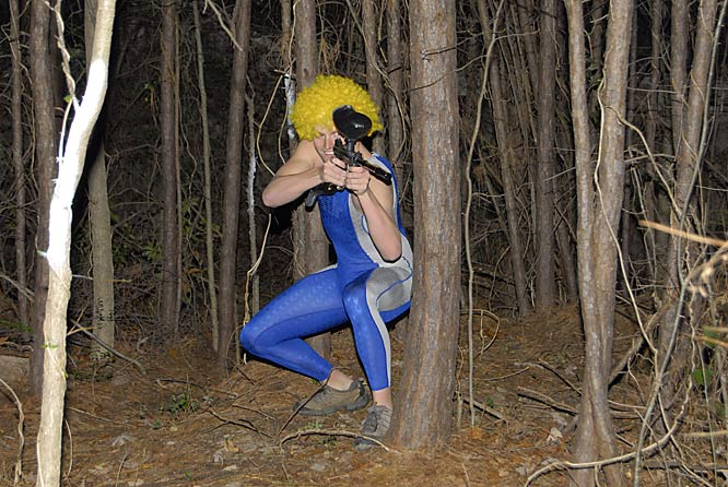 Weniger keeps potential intruders out of the woods behind his property with his paintball gun. The yellow wig and blue Speedo make up the perfect attire to remain inconspicuous.