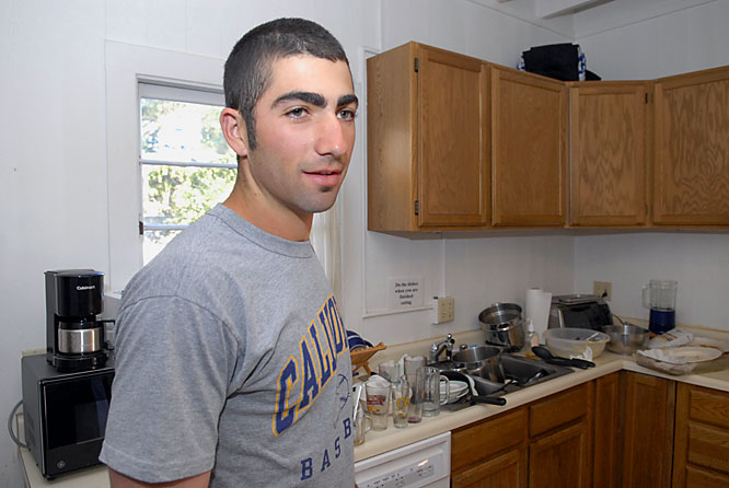 "It's baseball season, and that means chores might not always get done on time. Standing in the kitchen, Satin observes the dishes and glasses littered around the sink area. ""We do usually do them once a week,"" he says. ""It's getting to be that time now."""