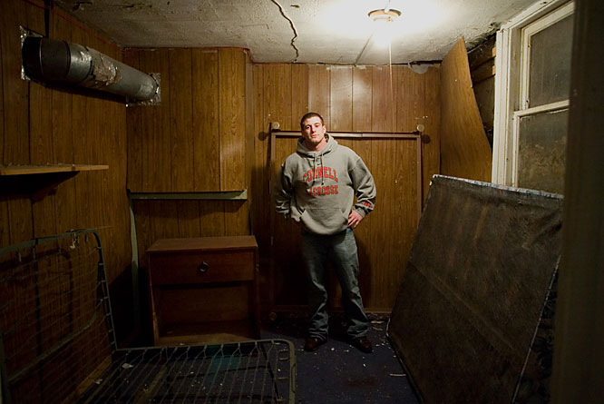 "It wouldn't be a college house without a crumbling room in the basement.  Here,  Belisle poses in what the housemates affectionately call the ""Blair Witch Project Room."""