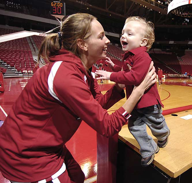Arkansas' Danielle Allen spends time with her No. 1 superfan, 17-months-old son Caden, before a game against LSU on Thursday.