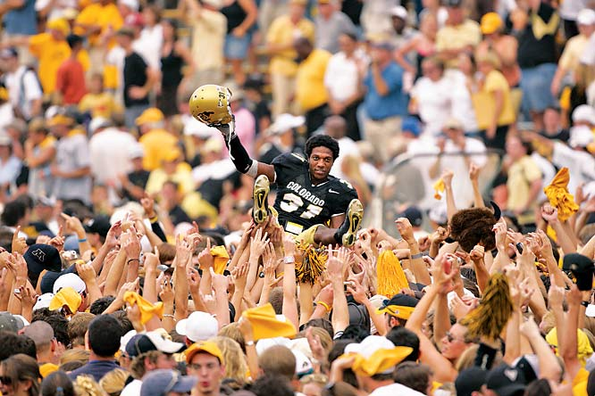 Colorado students give Gerrett Burl a lift after the Buffaloes scored 20 points in the final two minutes and 32 seconds to defeat Colorado State, 31-28, in September 2005.