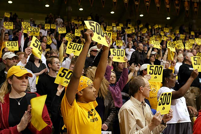 Colorado fans celebrate women's basketball coach Ceal Barry's 500th career victory with a win over Kansas in February 2004.
