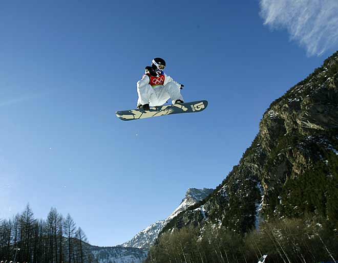 Tielemans's take:<br><br>''The challenge of the halfpipe is that you don't know where the jumps will be. I'd seen Shaun White practice and make two runs, so I picked a spot where I thought I could shoot two jumps coming at me, then one behind me with a wide lens showing the crowd below. As he approached the third jump, it was clear he was way too close to me. He soared right over me and I blindly framed my camera to get what I could. This wound up on the cover of SI.''<br><br>Shot with a Canon EOS-1D Mark II N  EF 16-35mm f 2.8L