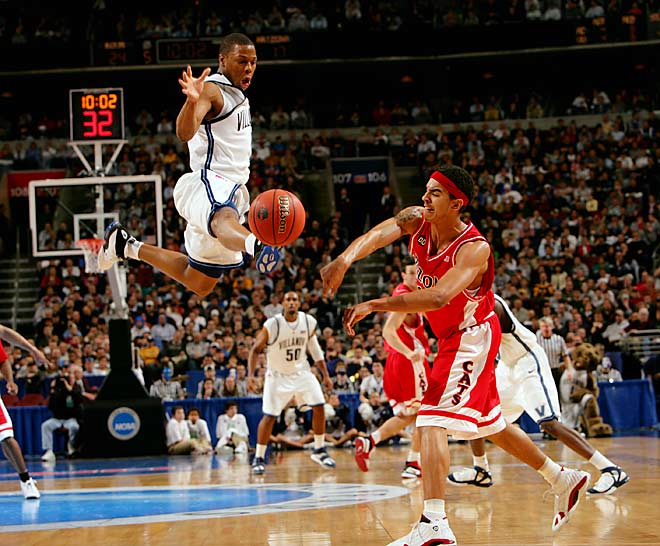 Tielemans's take:<br><br>''Villanova's Kyle Lowry played suffocating defense -- all the time. During the first two rounds of the 2006 NCAA tournament, I literally spent both Villanova games keying on him because I felt he had a great picture in him. SI usually runs only unique shots from those rounds because there are so many games during opening weekend. I knew I had some leeway, and Lowry did not disappoint.''<br><br>Shot with a Canon EOS-1DS Mark II   EF 70-200 f 2.8 L  IS