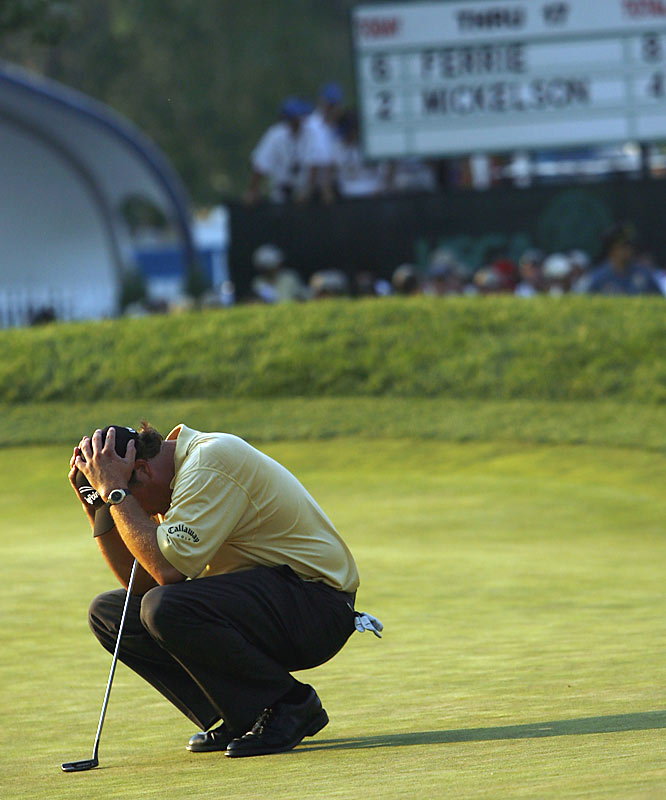 Tielemans's take:<br><br>''Father's Day 2006. Phil Mickelson had the U.S. Open sewn up going to the last hole, but it fell apart in a hurry. He was all over the 18th, and when the reality of his collapse began to sink in, he brought his hands to his head. It was devastating to watch, but it really drove home exactly how difficult it is to win one of golf's majors.''<br><br>Shot with a Canon EOS-1D Mark II N   EF 70-200 f 2.8 L IS