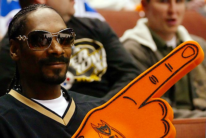 Anyone else think Snoop, shown here at a Wild-Ducks playoff game, loses some of his street cred by wearing the foam finger?
