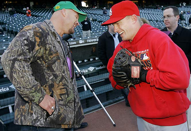 Stone Cold Steve Austin and Cardinals shortstop David Eckstein share a laugh. One second later, Eckstein was on his back after taking a Stone Cold stunner.