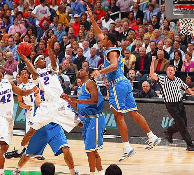 Corey Brewer goes up for two of his team-high 19 points as UCLA's Josh Shipp attempts the block.