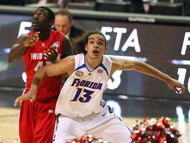 Florida's Joakim Noah and Ohio State's Othello Hunter fight for position in the paint.