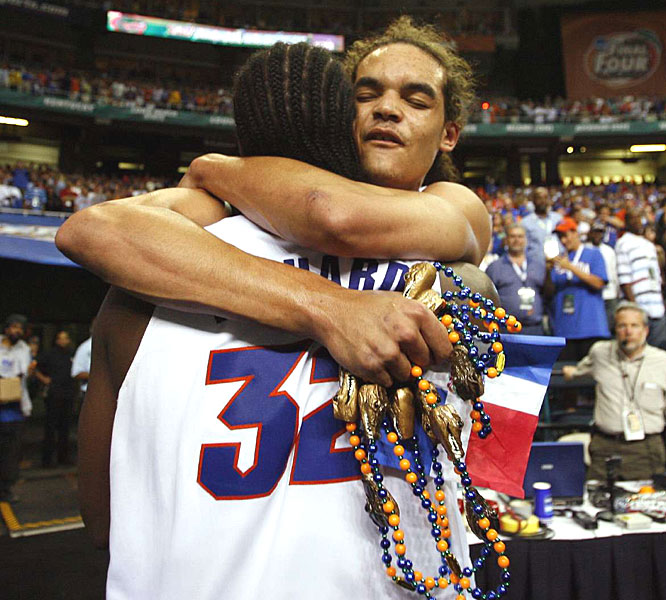 Joakim Noah and Chris Richard celebrate after the Gators became the first team to repeat since 1992.
