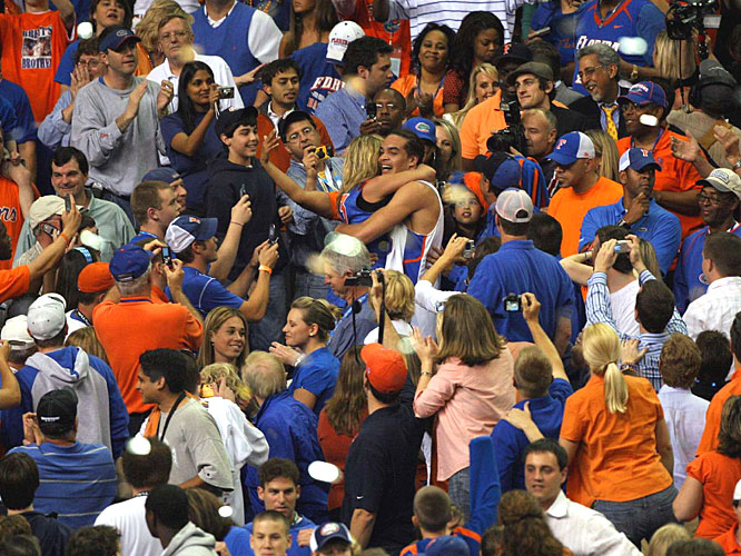 Joakim Noah finds his mother in a sea of fans after the Gators won their second straight NCAA title.
