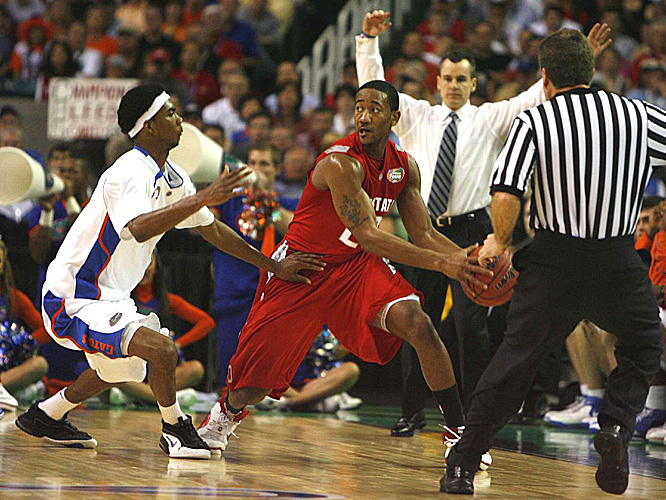 Ohio State's David Lighty fends off the defense of Florida's Corey Brewer.