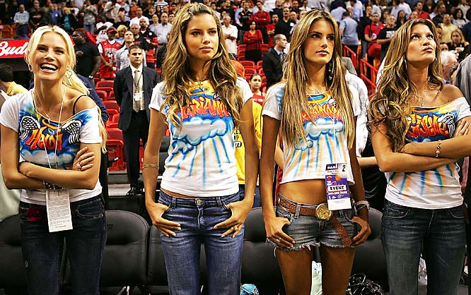 The Victoria's Secret models gently remind us that they have names while at a Wizards-Heat game.