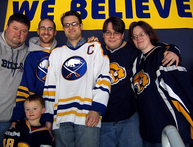 Sign of the Times: Joe DeLuca (in white Sabres jersey) poses with his fellow Section 300 patrons at the HSBC Arena.