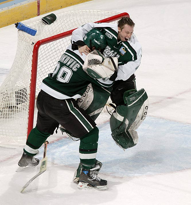 Michigan State goalie Jeff Lerg and defenseman Daniel Vukovic celebrate after defeating Boston College 3-1 to win the 2007 NCAA Hockey Frozen Four Championship.