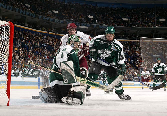 Michigan State defenseman Tyler Howells (16) and Boston College forward Ben Smith (12) watch another save by Lerg.