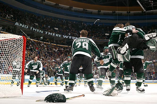 Michigan State players celebrate their school's first Frozen Four title since 1986.