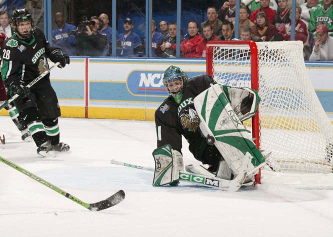 Boston College scored four goals against North Dakota goalie Phillippe Lamoureux in the final seven minutes to break a 2-2 tie.