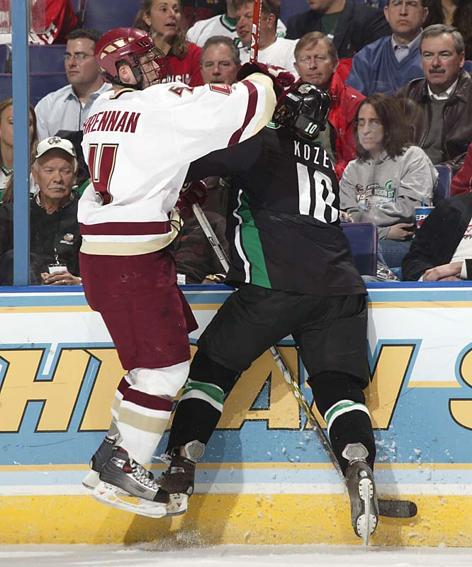 Boston College's Mike Brennan battles against the boards with North Dakota's Andrew Kozek.